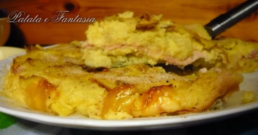 torta-salata-patate-ricetta-Torta-di-patate-prosciutto-cotto-mozzarella-evidenza