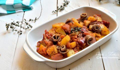 Patate, pomodori ed alici sott'olio in padella